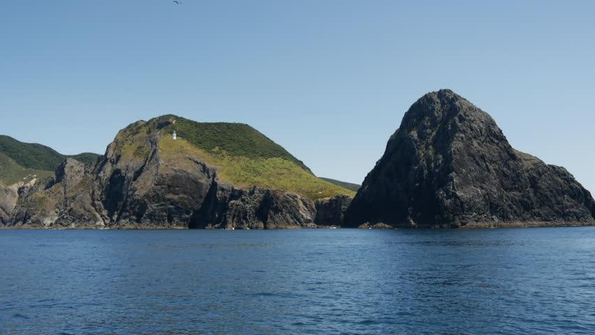 Sailing away from The Hole in the Rock at Percy Island/Motuk?kako Bay of Islands, New Zealand