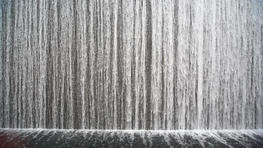 close shot on big beautiful artificial waterfall indoor