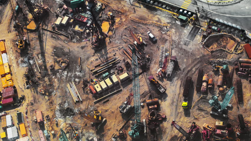 Top view timelapse video of construction site in beginning of building new housing project in Hong Kong. Workers and machinery move fast and busy on development area  | Shutterstock HD Video #9692162