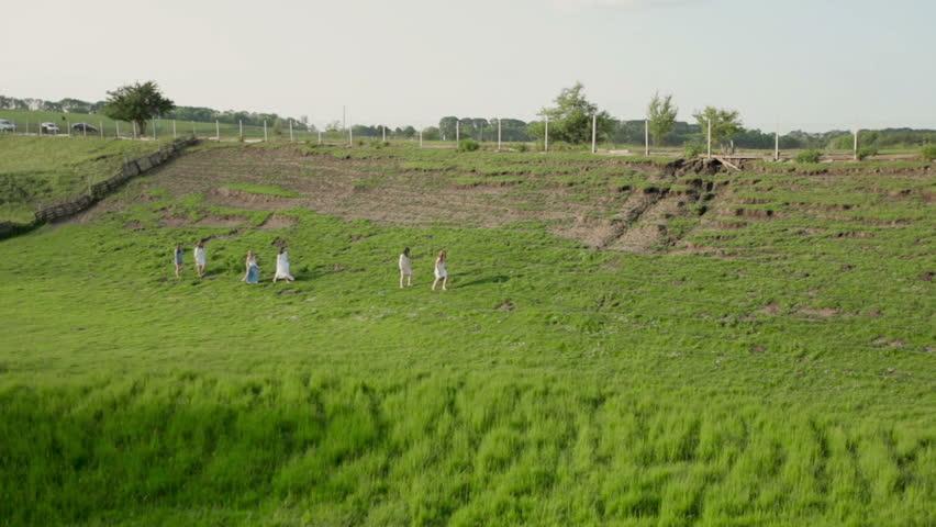 Girls running on the field | Shutterstock HD Video #9719192