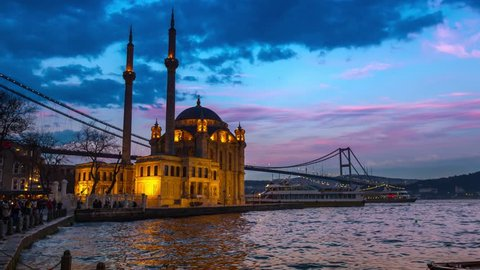 Day to night time lapse scene of the beautiful renovated Ortakoy mosque in Istanbul with Bosphorus bridge in the background. 4K Time-Lapse.