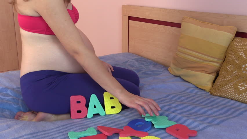 Pregnant Woman Sit On Bed And Pick Word Boy From Colorful -3599
