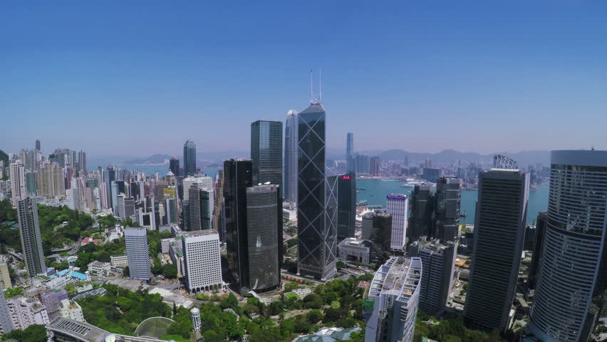 Beautiful Clear Sky Hong Kong City Aerial. 4K Aerial view of Central of Hong Kong. Tight aerial forward shot flying over office buildings and skyscrapers.  | Shutterstock HD Video #9871238
