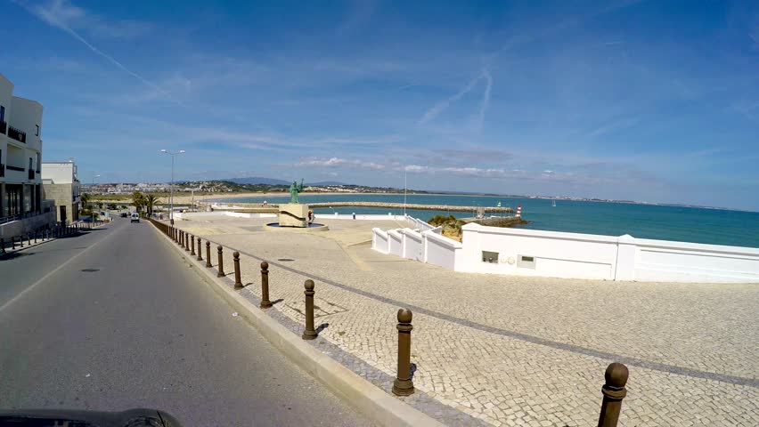 Algarve, Portugal - CIRCA 2015 Driving on Avenida dos Descobrimentos, Lagos, Algarve, Portugal  April 2015, Lagos was de main shipyard where the caravels were built and the departing for the portuguese discoveries | Shutterstock HD Video #9874622