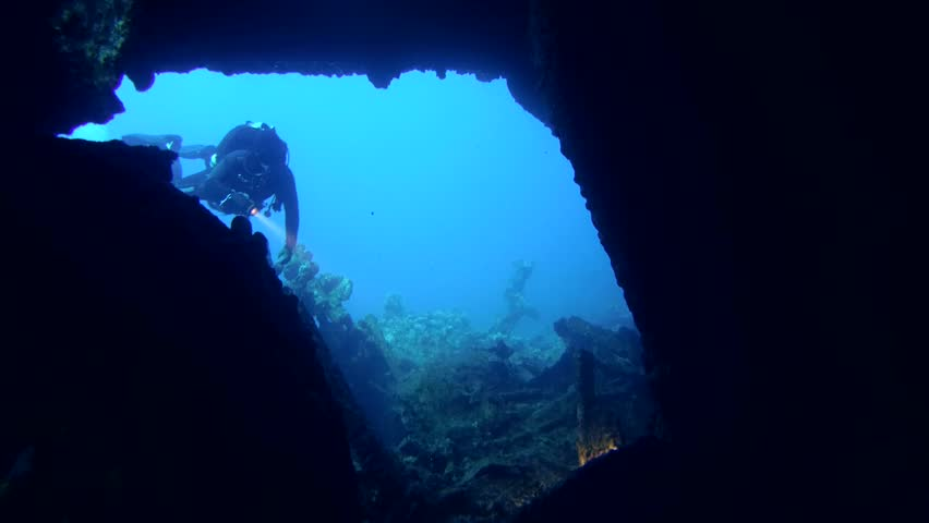 STRAIT OF GUBAL, RED SEA, EGYPT - OCTOBER, 2014: A diver swims inside wrecked ship SS Carnatic, Red Sea, Egypt   | Shutterstock HD Video #9895328
