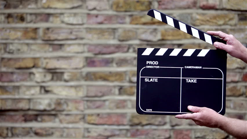Clapperboard. Video footage of hands coming into view holding a video production clapper board; variations of blank board included.