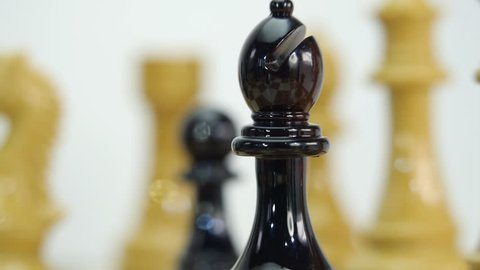 Chess Board and Pieces. Knight, horse. Closeup. Shallow depth of field. Dolly shot. Follow focus