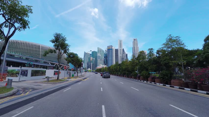 SINGAPORE - CIRCA APRIL 2015: POV, driving to business district Raffles Place.