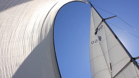 Sailing in the wind through the waves. Full sails, very strong wind. Ocean race, real adventure. Pirates on holidays. Storm day. Real spray. Sun sails, and adventure.